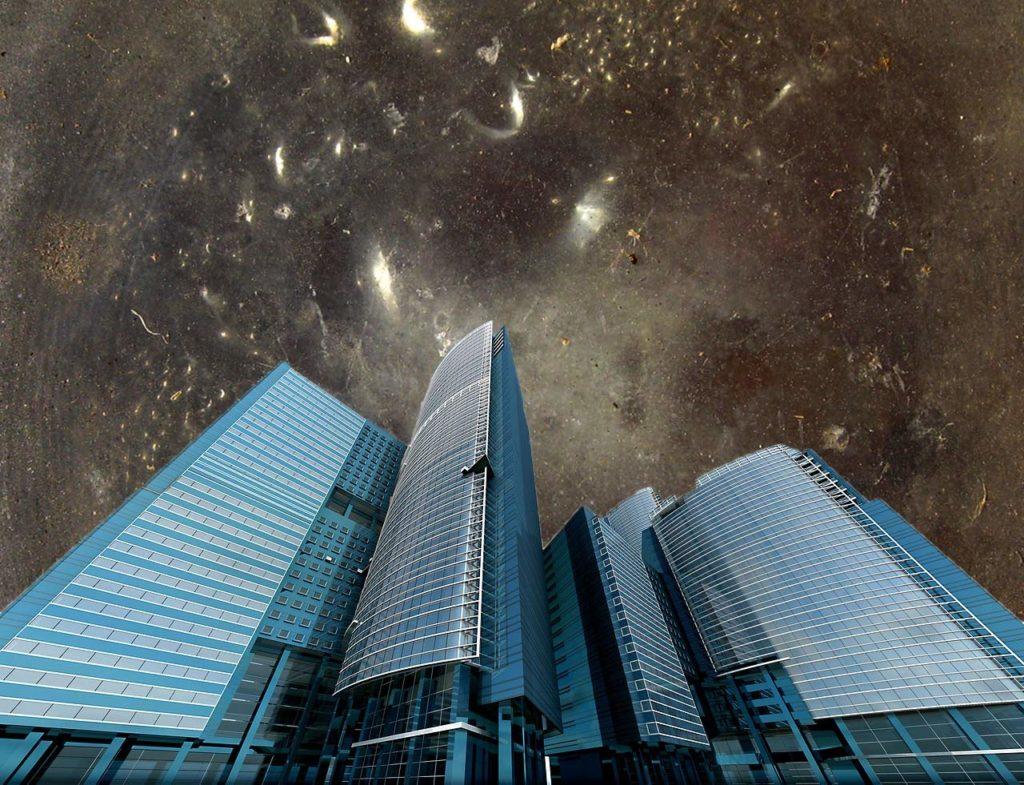 Premier plan d'immeubles modernes, sur fond de ciel noir de galaxies
